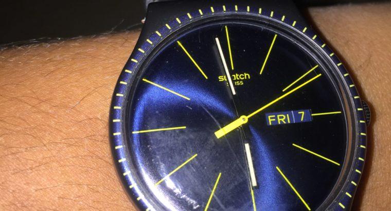 montre swatch oroginal presque nuef